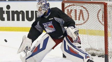 Rangers goalie Henrik Lundqvist makes a save during
