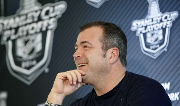 Rangers head coach Alain Vigneault answers questions from