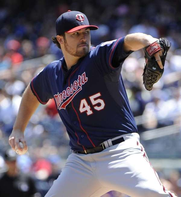 Minnesota Twins starting pitcher Phil Hughes delivers against