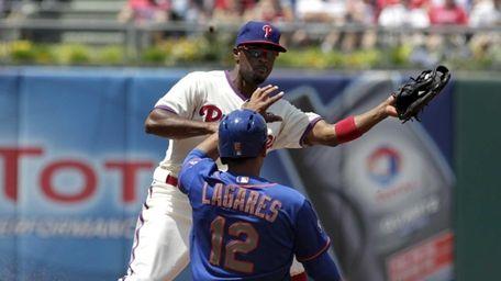 The Mets' Juan Lagares steals second as Philadelphia