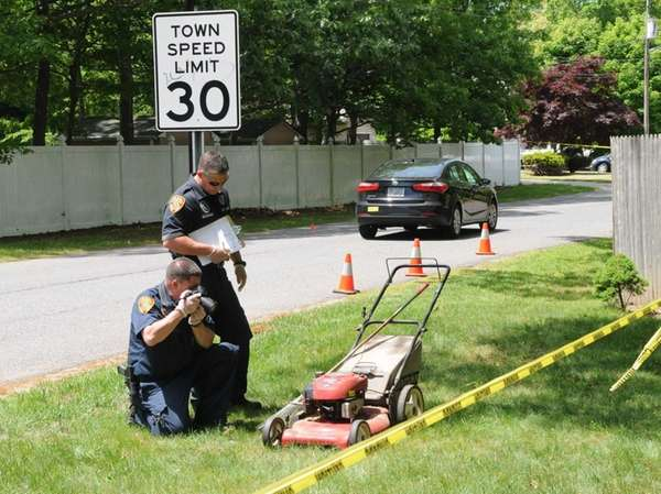 Investigators examine the scene where Valerie Fahie, 62,
