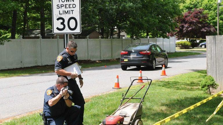 Investigators examine the scene where Valerie Fahie, 62,