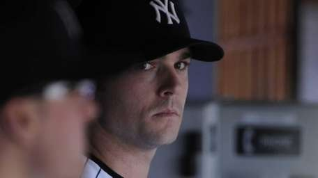 Yankees pitcher David Robertson sits in the dugout