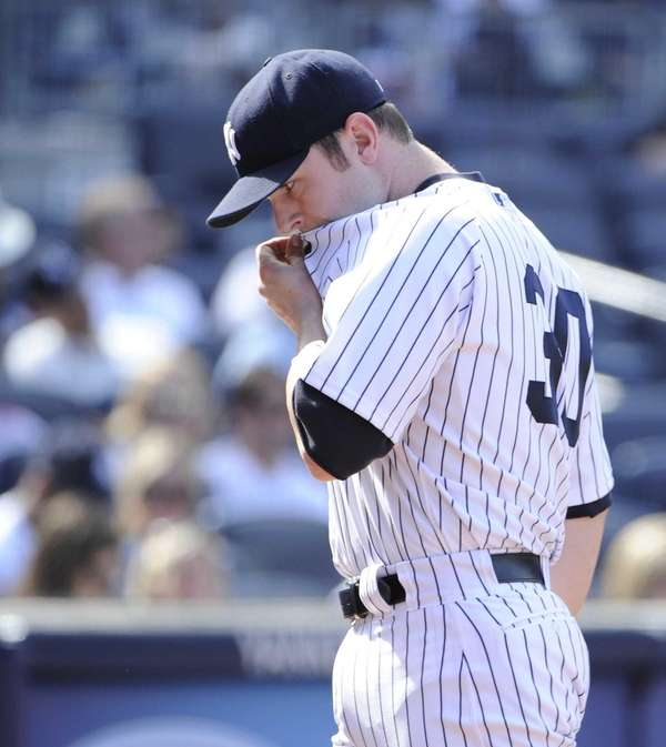 Yankees pitcher David Robertson reacts as he walks