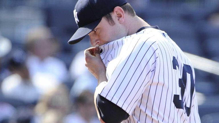 Yankees pitcher David Robertson reacts as he walks