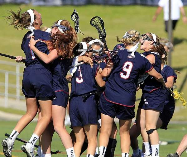 Cold Spring Harbor's girls lacrosse team celebrates its