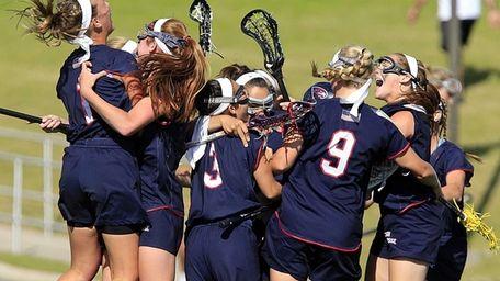 Cold Spring Harbor's girls lacrosse team celebrates its