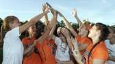 The Manhasset girls lacrosse team holds up its
