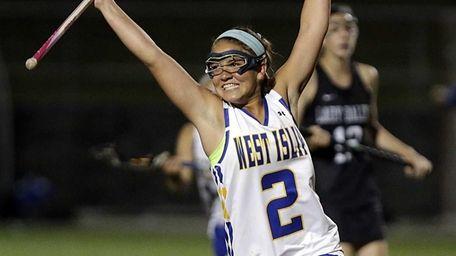 West Islip's Lena Riportella (2) celebrates a score