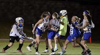 West Islip girls lacrosse players celebrate after defeating