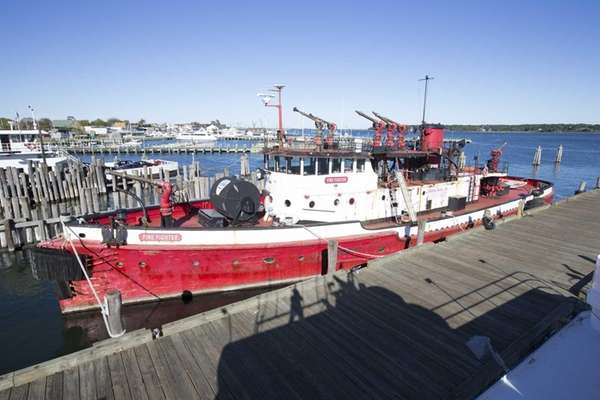 The Greenport Fireboat Firefighter Museum is pictured on