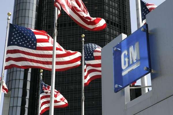 Flags fly outside the Detroit headquarters of General
