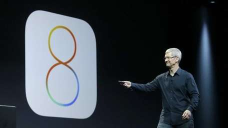 Apple CEO Tim Cook demonstrates some of iOS