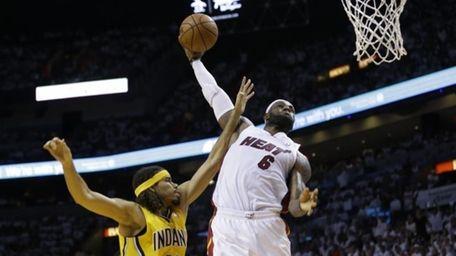 Miami Heat forward LeBron James drives to dunk