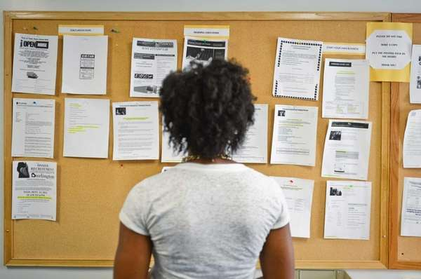 Nina Ohakam, of Islandia, searches for job applications