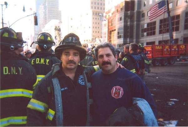 Firefighter Steven B. Reisman, right, of Roslyn Heights,