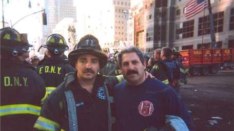 Firefighter Steven B. Reisman, right, of Roslyn Heights,