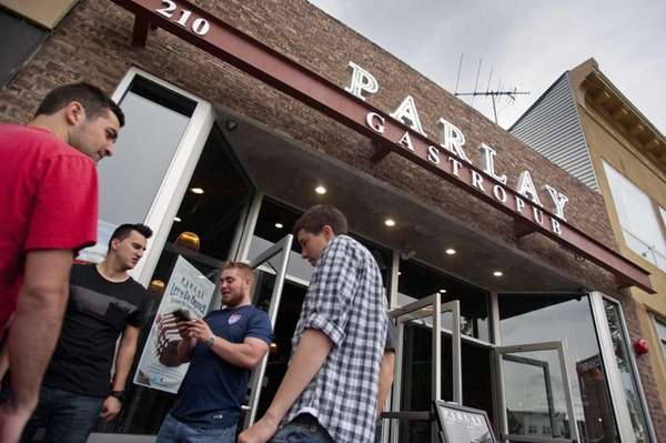 Patrons gather outside Parlay, the new gastropub in
