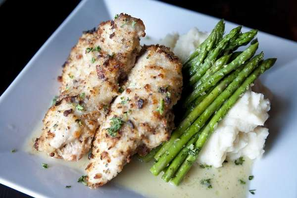 Juicy, onion-crusted chicken is served with asparagus at