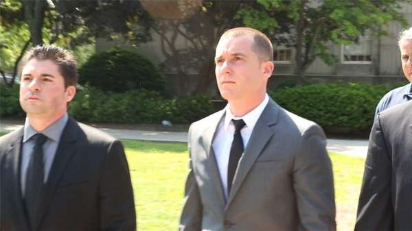 Nassau County police Officer Vincent LoGiudice, center, appeared