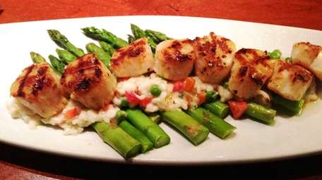 Caramelized grilled sea scallops with creamy lemon risotto,
