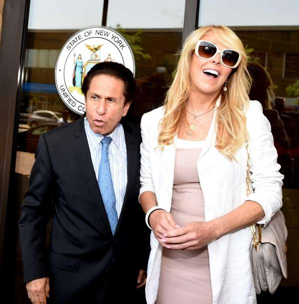 Attorney Mark Heller and Dina Lohan leave Nassau