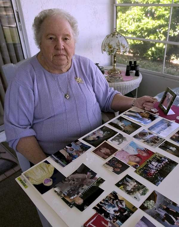 Shirley Findel looks over photos from her husband's