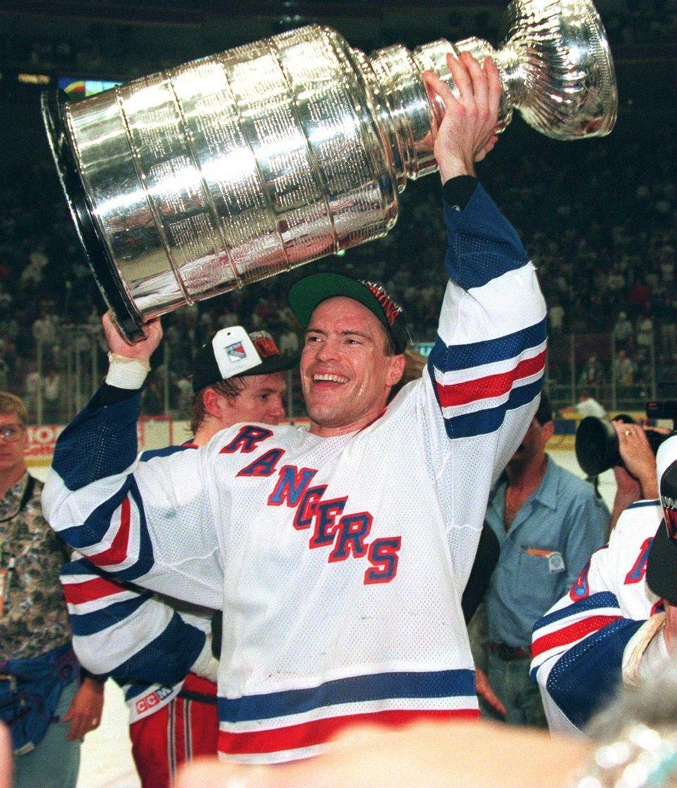 New York Rangers Captain Mark Messier hoists the