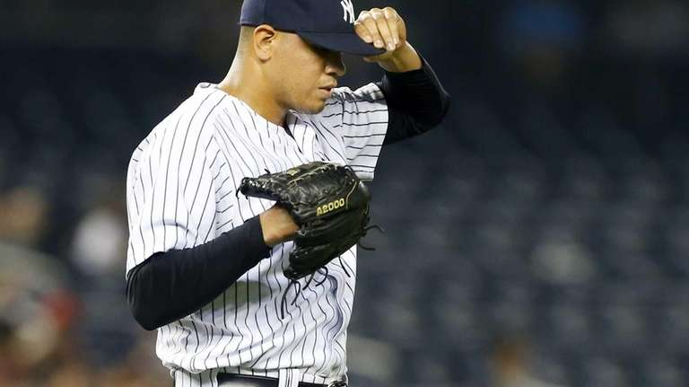 Dellin Betances of the Yankees reacts after surrendering
