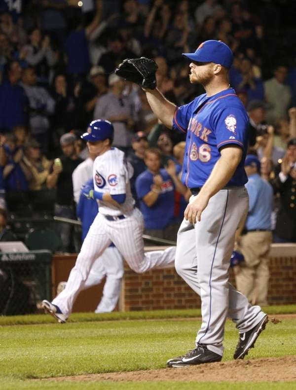 Mets relief pitcher Josh Edgin, right, calls for