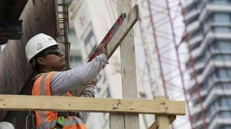 A construction worker works on the site of