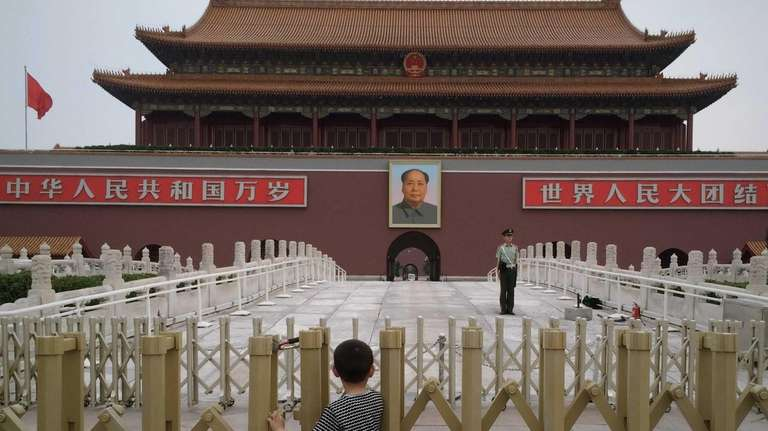A Chinese boy waits for the customary ceremony