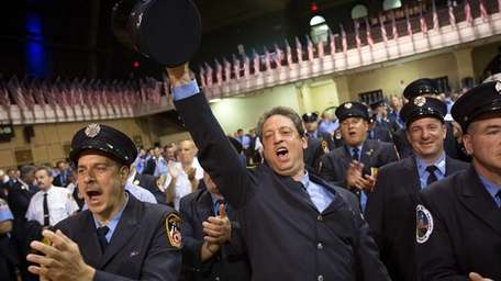Firefighters cheer on their friends and colleagues at