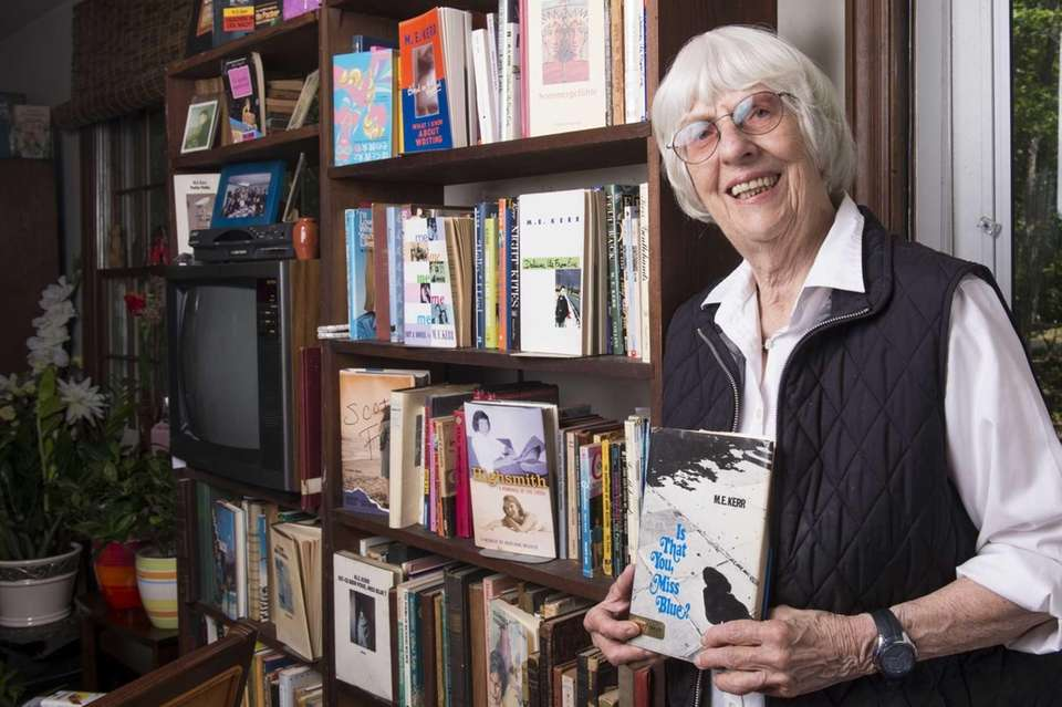 Author Marijane Meaker with a bookcase full of