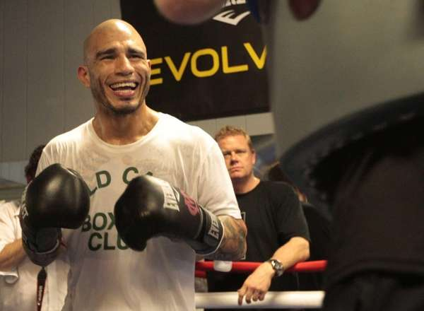 Boxer Miguel Cotto smiles while working out with