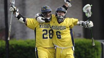Massapequa attacker Paul Dilena, left, celebrates his goal
