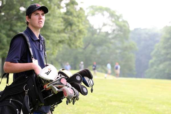 Sean Donovan of Glen Cove, caddie at North