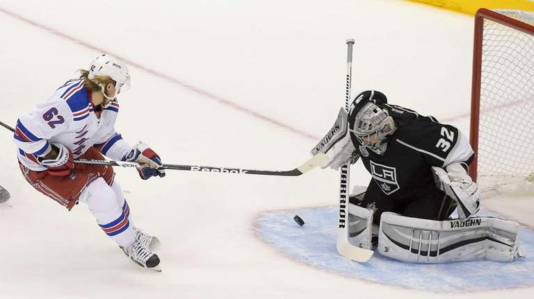 Rangers left wing Carl Hagelin scores past Los