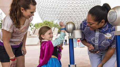 Walt Disney World Resort guests use MagicBands for