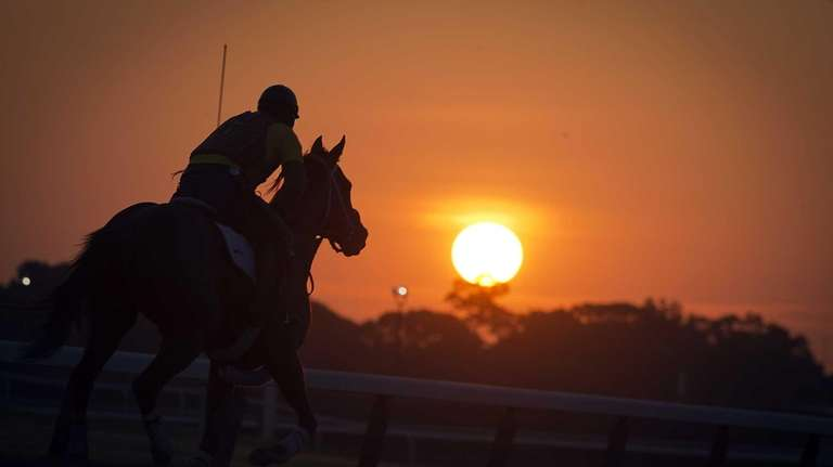 Exercise riders and outriders hitting the track in