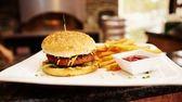 A vegan bacon cheeseburger is highly satisfying at