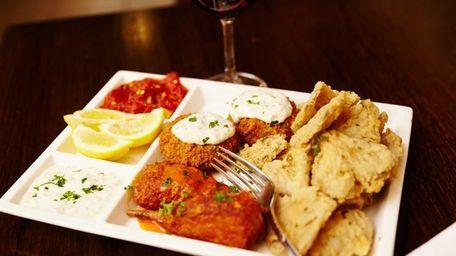 The appetizer trio features tofu crabcakes, oyster mushroom