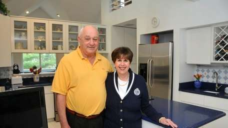 Irene and Mike Geisinger show the kitchen of