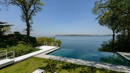 The infinity edge pool and spa in the