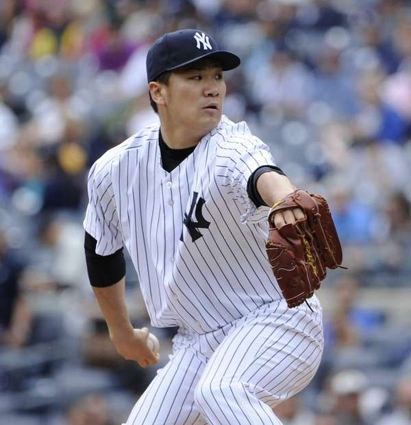 Yankees starting pitcher Masahiro Tanaka delivers against the