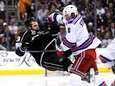 Anton Stralman of the Rangers checks Kyle Clifford