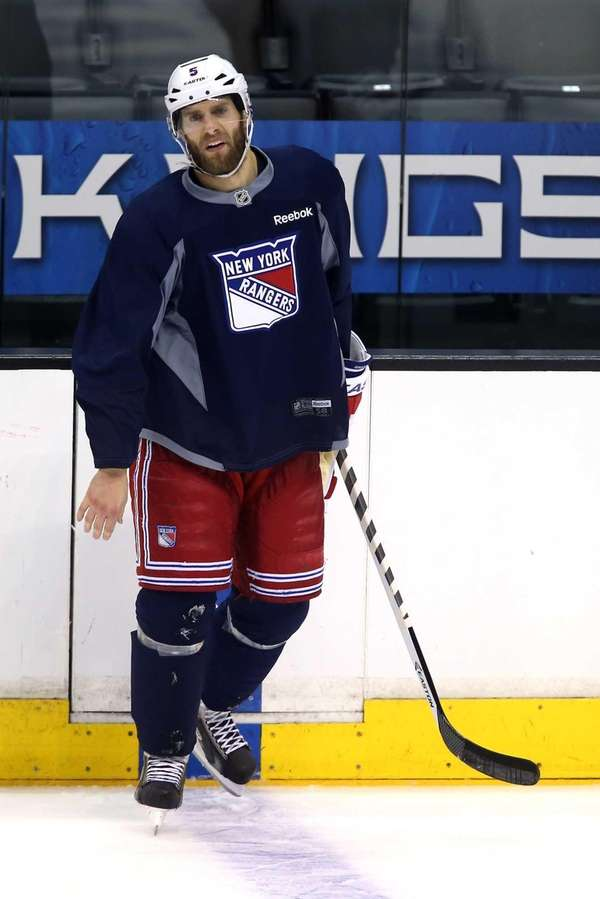 Dan Girardi of the Rangers looks on during