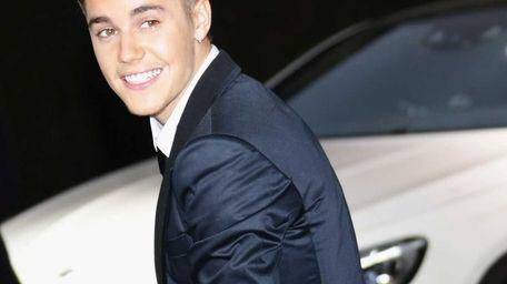Justin Bieber attends amfAR's 21st Cinema Against AIDS