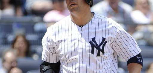 Yankees' Carlos Beltran reacts after he strikes out