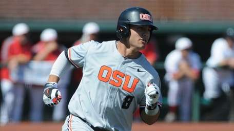 Oregon State's Michael Conforto rounds first base on